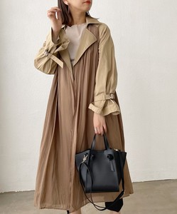 Material Layard Over Long Trench Coat
